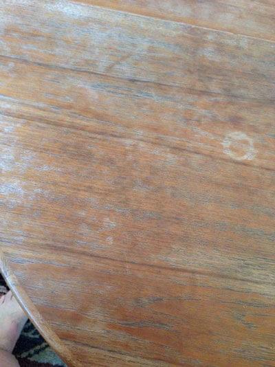 Photo of a teak laminate table that needs refinishing.