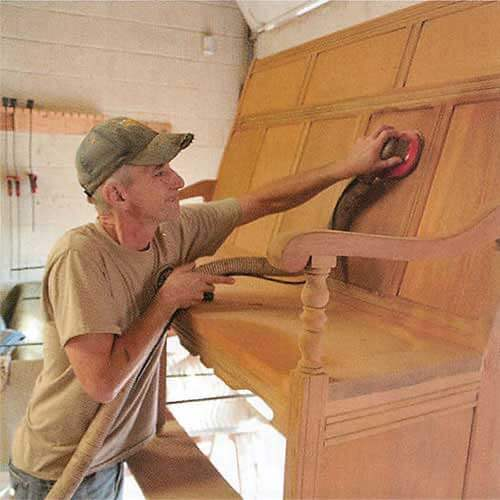 Rob Barnhill restores a larger piece of furniture.
